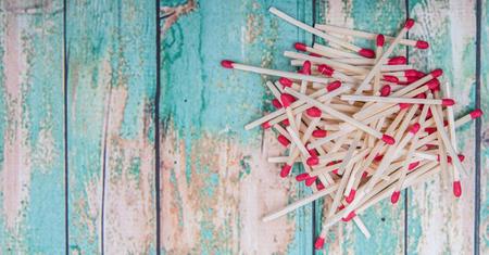 match head: Matchsticks over wooden background Stock Photo