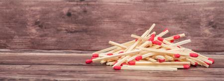 unlit: Matchsticks over wooden background Stock Photo