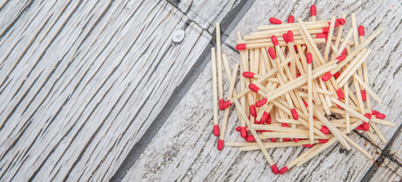 consumable: Matchsticks over wooden background Stock Photo