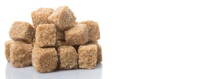 Brown sugarcane sugar cube over white background