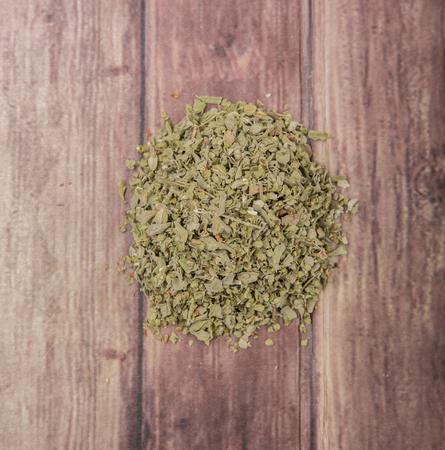 marjoram: Dried marjoram herbs over wooden background