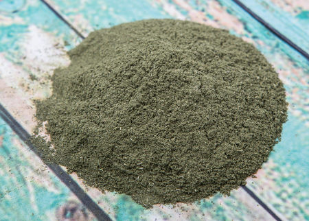 minty: Peppermint herbs powder over wooden background
