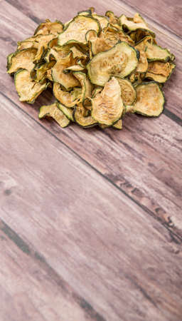 courgette: Dried zucchini or courgette over wooden background Stock Photo