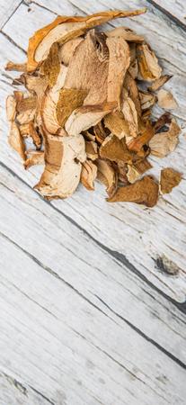 porcini: Dried porcini mushroom over wooden background