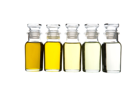 grape seed: Avocado oil, olive oil, sesame seed oil, grape seed oil and corn oil in glass vial over white background