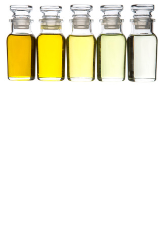 grape fruit: Avocado oil, olive oil, sesame seed oil, grape seed oil and corn oil in glass vial over white background