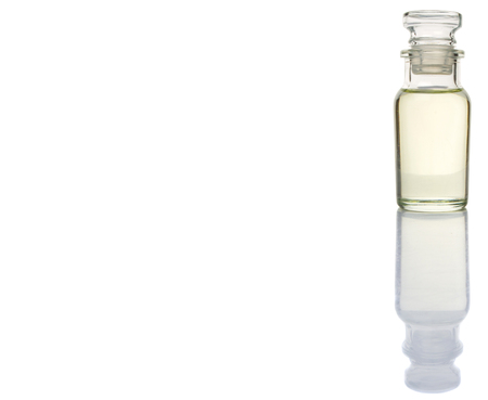 Corn vegetable cooking oil in vial glass over white background