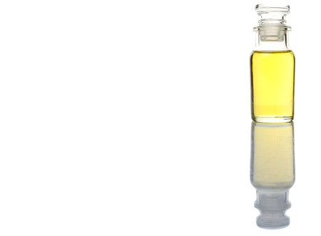vial: Sesame seed oil in glass vial over white background