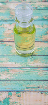 grape seed: Grape seed oil in glass vial over wooden background Stock Photo