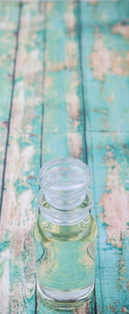 vial: Corn vegetable cooking oil in vial glass over wooden background