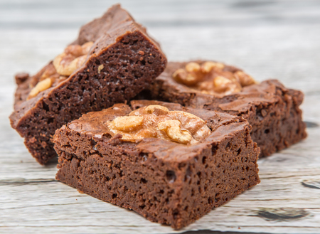 Chocolate walnut brownies over wooden background Stock Photo