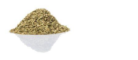 tarragon: Dried tarragon herb over white background Stock Photo