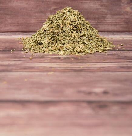 tarragon: Dried tarragon herb over wooden background