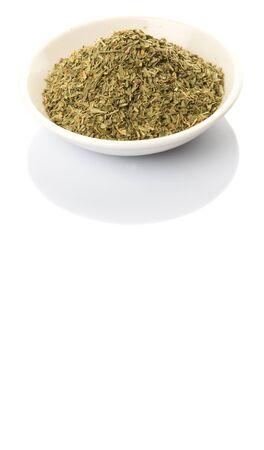 tarragon: Dried tarragon herb in white bowl over white background