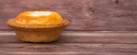 sweet and savoury: Homemade Japanese cheese tart over wooden background