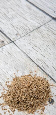 aniseed: Dried anise seed or aniseed over wooden background Stock Photo
