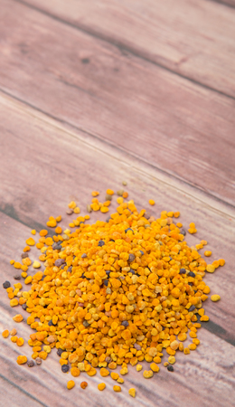 ambrosia: Bee pollen over wooden background