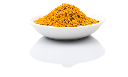 Bee pollen over white background