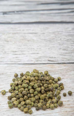 peppercorn: Dried green peppercorn wooden background Stock Photo
