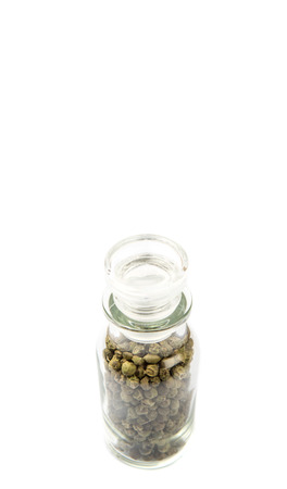 vial: Green peppercorn in glass vial over white background Stock Photo