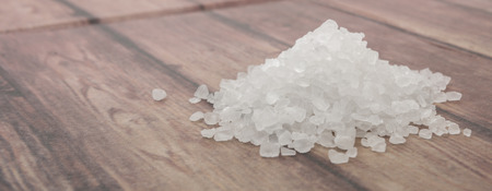 salty: Sea salt over wooden background