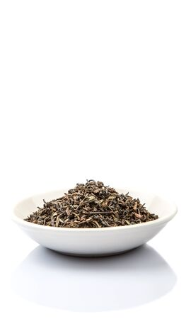 darjeeling: Loose dried darjeeling black tea leaves in white bowl over white background