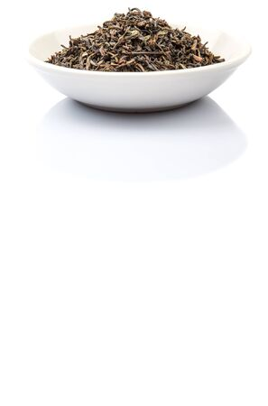 darjeeling: Loose dried darjeeling black tea leaves in white bowl over white background