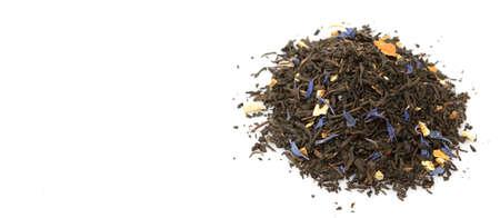 earl: Dried black Earl Grey tea leaves over white background Stock Photo