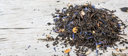 earl: Dried black Earl Grey tea leaves over wooden background Stock Photo