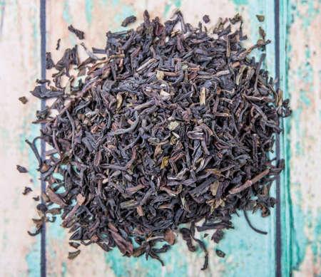 darjeeling: Loose dried darjeeling black tea leaves over wooden background