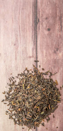 darjeeling: Loose dried darjeeling black tea leaves over wooden background