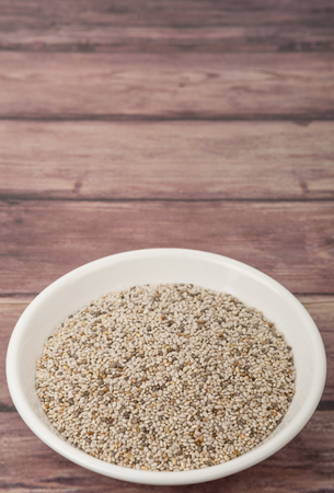 white chia: White chia seed in white bowl over wooden background