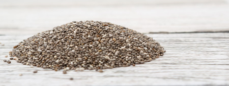 hispanica: Dried black chia seed over wooden background Stock Photo
