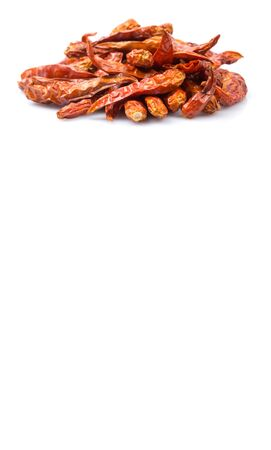 dry cow: Dried cayenne pepper over white background