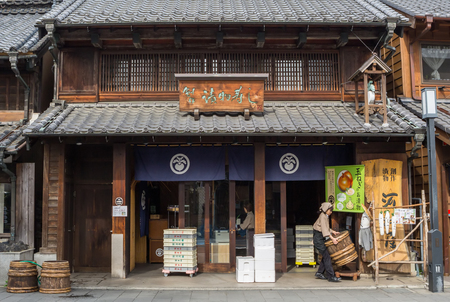 architectural tradition: Kawagoe, Saitama, Japan - 9th April 2016. Locals and tourists in Kawagoe town. Originating from Japans Edo Period, Kawagoe town is also known as Little Edo.