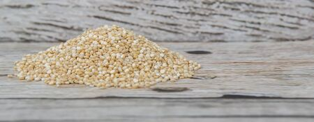 protein crops: White quinoa grain over wooden background