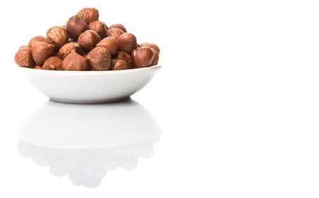 peeled: Peeled hazelnut nut over white background