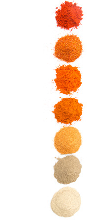 white pepper: Pile of hot and spicy spices powder, cayenne powder, chilly powder, peppercorn powder, paprika powder, black pepper and white pepper powder over white background