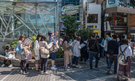 omotesando: TOKYO, JAPAN - MAY 3RD, 2016. Tourists and locals walking in Omotesando, an upscale shopping district in Tokyo.