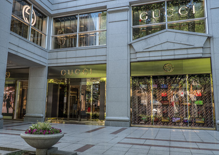 TOKYO, JAPAN - MAY 3RD, 2016. Exterior of a Gucci store in Omotesando, an upscale shopping district in Tokyo. Gucci is an Italian fashion and leather goods brand Editorial