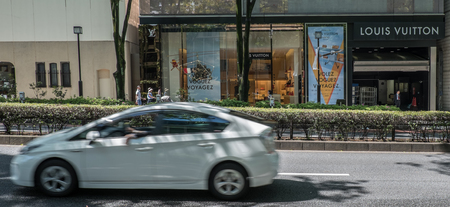 upscale: TOKYO, JAPAN - MAY 3RD, 2016. Exterior of a Louis Vuitton designer store in Omotesando, an upscale shopping district in Tokyo. Editorial