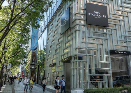 omotesando: TOKYO, JAPAN - MAY 3RD, 2016. Exterior of a Coach store in Omotesando, an upscale shopping district in Tokyo.