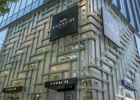 upscale: TOKYO, JAPAN - MAY 3RD, 2016. Exterior of a Coach store in Omotesando, an upscale shopping district in Tokyo.