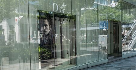 upscale: TOKYO, JAPAN - MAY 3RD, 2016. Exterior of a Dior store in Omotesando, an upscale shopping district in Tokyo. Editorial