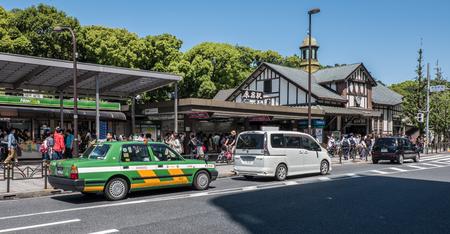 harajuku: TOKYO, JAPAN - MAY 3RD, 2016. Locals and tourists in front of Harajuku Station, Tokyo. Editorial
