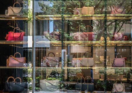 gucci store: TOKYO, JAPAN - MAY 3RD, 2016. Exterior of a Gucci store in Omotesando, an upscale shopping district in Tokyo. Gucci is an Italian fashion and leather goods brand.