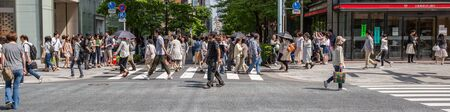 upscale: GINZA,TOKYO, JAPAN - MAY 6TH, 2016. Tourists and locals walking in Ginza Street, an upscale and popular shopping district in Tokyo. Editorial