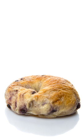 doughy: Homemade blueberry bagel over white background Stock Photo