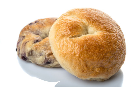 doughy: Plain bagel and blueberry bagel over white background