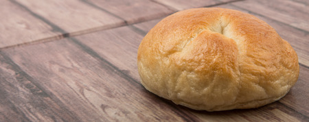 doughy: Plain homemade bagel over wooden background